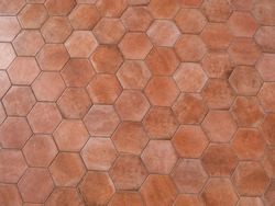Terra cotta background material. Honeycomb type red brick tile.