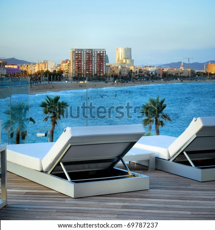terrace and bar of modern hotel in barcelona with  kind on  beach of mediterranean sea
