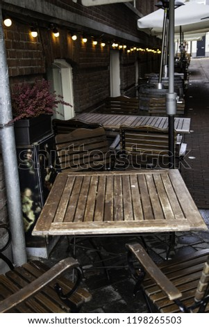 Terrace in amsterdam, detail of tables and chairs in the city