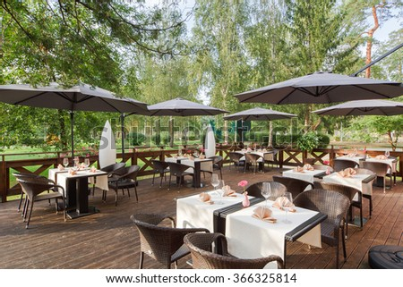 terrace restaurant in the park, with a table setting.