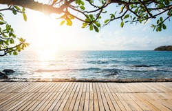 Terrace view sea tree sunlight wooden table on the beach landscape nature with sunset or sunrise / wooden bridge balcony view seascape idyllic seashore silhouette tropical tree summer vacation beach