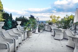 Terrace With White Whicker Furniture In The Park At Sea Beach. Vintage Background