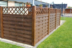Terrace wooden fence with privacy lattice screen.