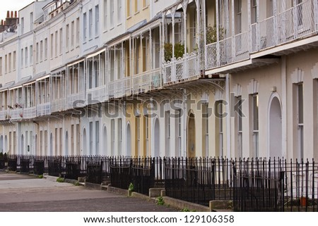 Terraced housing in a Georgian crescent in Clifton, Bristol UK - stock photo