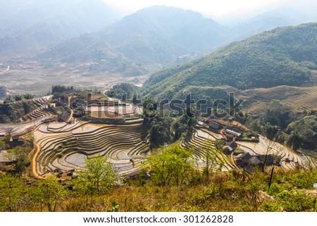 Terraced rice fields - Terraced rice fields with old houses - on sapa , Vietnam Laocai, Vietnam JAN 1, 2015