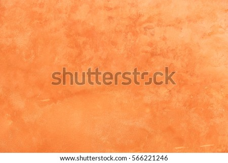 Terracotta brown stucco wall plaster texture.