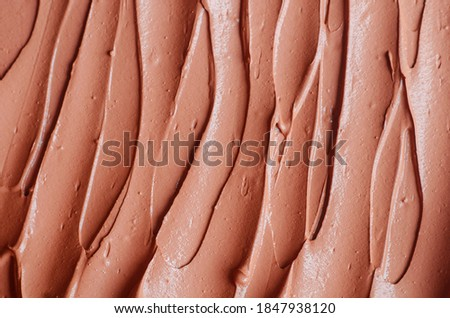 Terracotta cosmetic clay (alginate facial mask, face cream, body wrap) texture close up, selective focus. Abstract background with brush strokes.  Photo stock ©