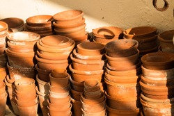 Terracotta pots; piles and stacks of empty orange vintage flowerpots. Filling the frame
