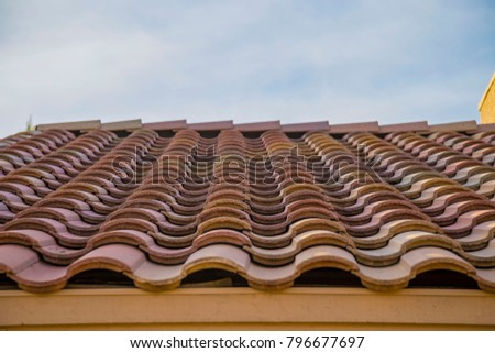 Terracotta roof blue sky spanish style house southwest corner edge gutter red  building arizona tucson home