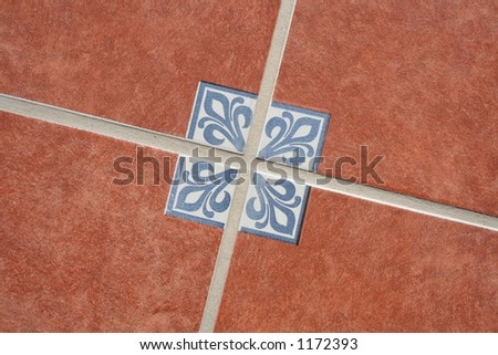 Terracotta tiles on the floor with a traditional Mexican pattern