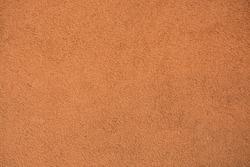 Terracotta wall plaster, high resolution closeup texture, background, wallpaper