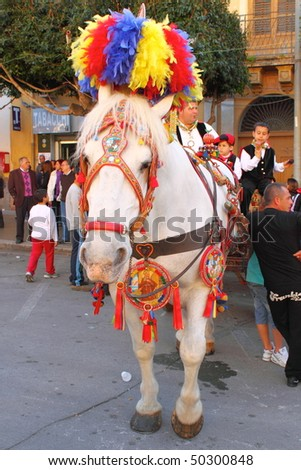 """TERRASINI - APRIL 3: Folkloristic parade of traditional horse-cars in Sicily during the """"Festa di li schietti"""" April 3, 2010 in Terrasini, Italy"""