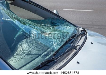 Terrible dangerous car after a fatal accident. Broken windshield. A broken car with broken glass. Сar hazard. Reckless dangerous driving. Broken windshield after fatal accident with a pedestrian