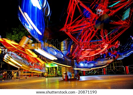 terrific speed of carousel in evening park