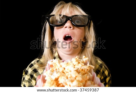 Terrified Girl Wearing New Style 3-D Glasses in a Movie Theater