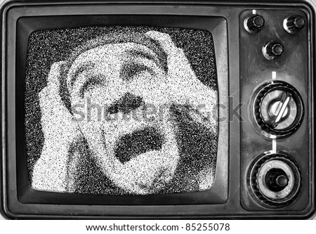 Terrified man on screen of vintage TV. Horror concept