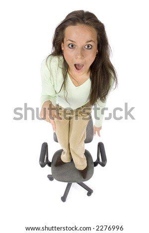 terrified woman standing on the office chair - white background, headshot