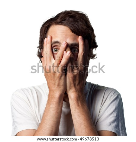 Terrified young man hides his face