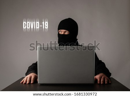 Terrorist is staying at home during the COVID-19 coronavirus outbreak. Terrorist worried about the Coronavirus. Quarantine concept.