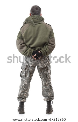 Terrorist standing - back view, isolated on white background