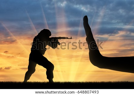 Terrorist with guns and hand gesture stop. The fight against terrorism concept