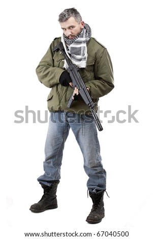 Terrorist with rifle, isolated on white background