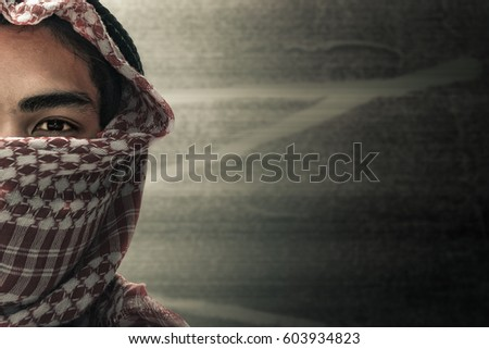 terrorists half face and eyes contact with masked and grunge background, terrorism and criminal concept ストックフォト ©