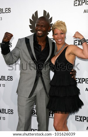 "Terry Crews and wife Rebecca Crews  at the ""The Expendables"" Film Screening, Chinese Theater, Hollywood, CA. 08--03-10"