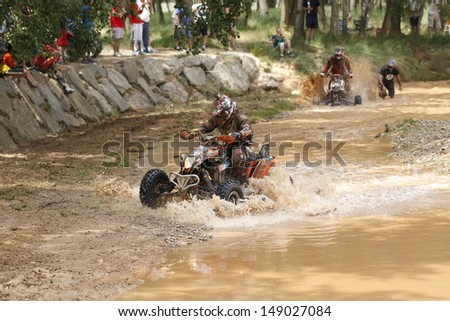 TERUEL, SPAIN - JULY 20 : Polish quad rider Kamil Wisniewski in a Yamaha Raptor 700, dorsal 251 and French quad rider Patrick Sanchez in a KTM XC, race in Baja Spain, on Jul 20, 2013 in Teruel, Spain.