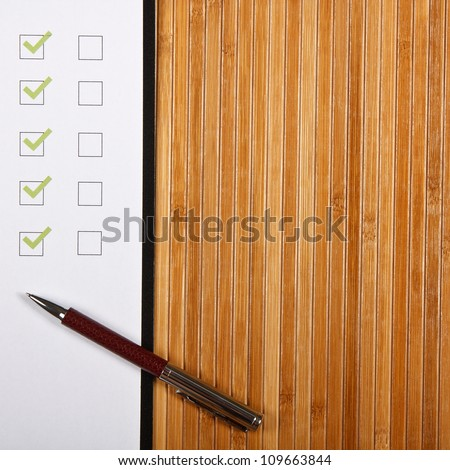 Test and an apple on a wooden table - stock photo
