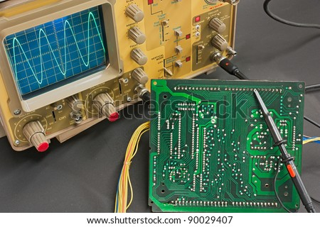 Test electronic board with oscilloscope - instruments of electronic service lab