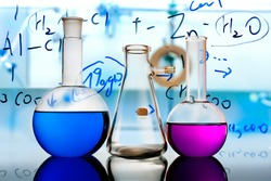 Test glass flask with solution in research laboratory. Science and medical background