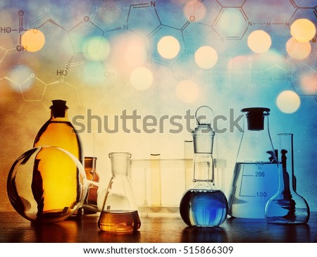 Test glass flask with solution in research laboratory. Science and medical background. Focus in the foreground. #515866309