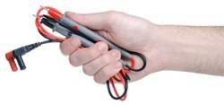 test leads for multimeter in hand on white background isolation
