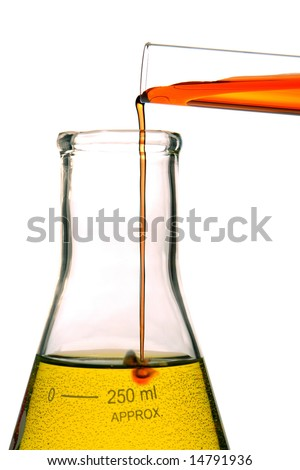 Test tube with red liquid pouring into a laboratory conical Erlenmeyer flask with yellow chemical solution and causing a reaction for an experiment in a science research lab