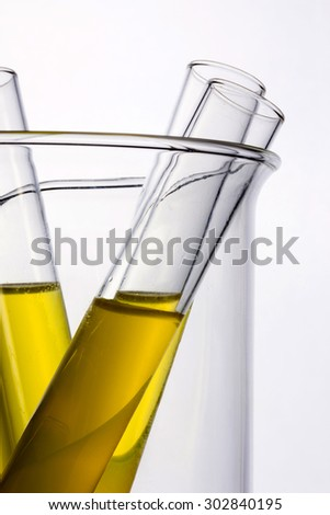 Test tube with yellow(urine) liquid(fluid, water) in the beaker for chemical, health, urology at the laboratory and white background.