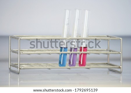 Test tubes containing solution are placed in stainless steel test tube rack. Stock photo ©
