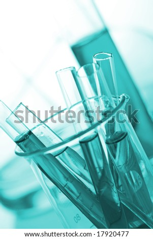 test tubes on green background