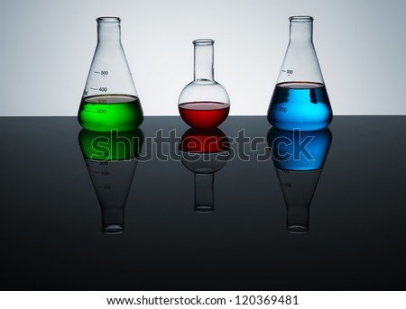 test tubes with colored liquid, a still life, a place for text