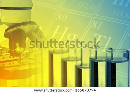 Test tubes with microscope and periodic system of the elements - chemistry or biology science background