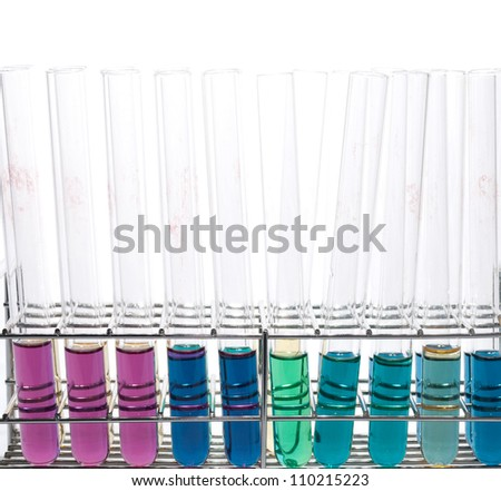 Test tubes with various colored liquids on test tube rack