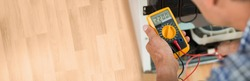 Testing Electric Appliance Using Multimeter To Repair Fridge At Home