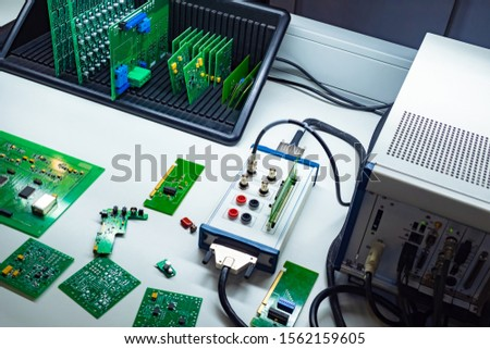 Testing of electronic components. Electrotechnical laboratory. Quality control of printed circuit boards. The workplace of the engineer. Equipment for testing of electronic components. #1562159605