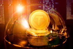 Tether bubble. Tether USDT coin in a soap bubble. Dangers and risks of investing to tether cryptocurrency. Speculation, drop, down