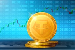 Tether cryptocurrency; Tether USDT golden coin on the background of the chart
