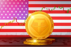 Tether USA; Tether USDT cryptocurrency golden coin on the background of the flag of United States