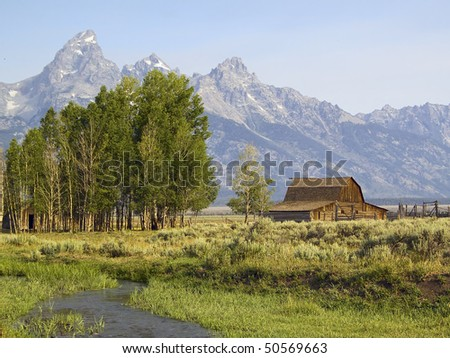 Teton Farm along Mormon Row, Antelope Flats, Grand Teton National Park, Wyoming with snow-capped Teton Mountain Range behind