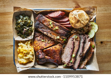 texas bbq style tray with smoked beef brisket, st louis ribs, chicken and hot links