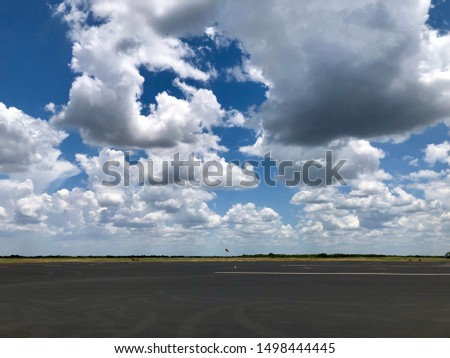 Texas cloudy day and runway #1498444445