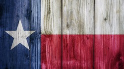 Texas flag on wood texture background